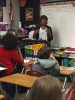 Demetria Wallace speaking with Biggersville Eighth Grade Students