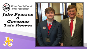 Pearson poses with Governor Reeves at the Electric Cooperative Youth Leadership Program
