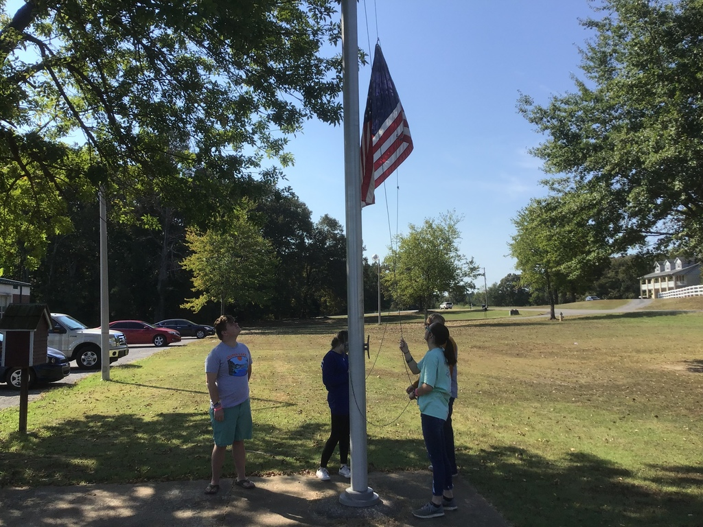 LPS Students lowering the US Flag to Half Staff