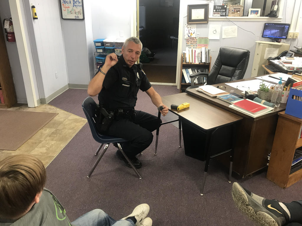 Officer Timbes visits the AAEC to speak with the students about good practice when they are involved in a traffic and the purpose of his taser.