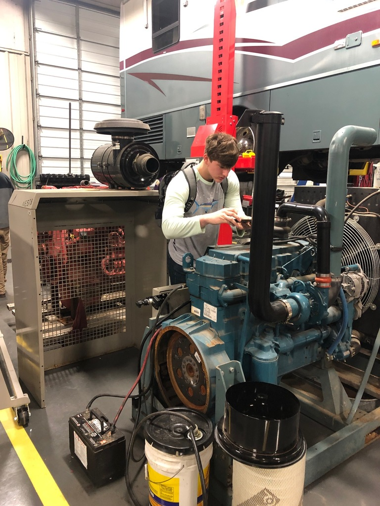 Rickey Rivera Checking Out a Motor in Diesel Technology