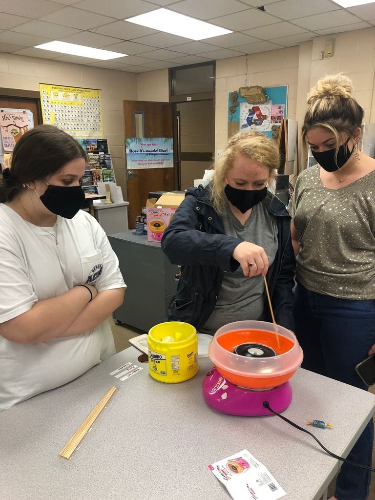 Polymer Science students use a cotton candy machine to demonstrate how to process spun fiber, a process used in manufacturing fiber insulation.