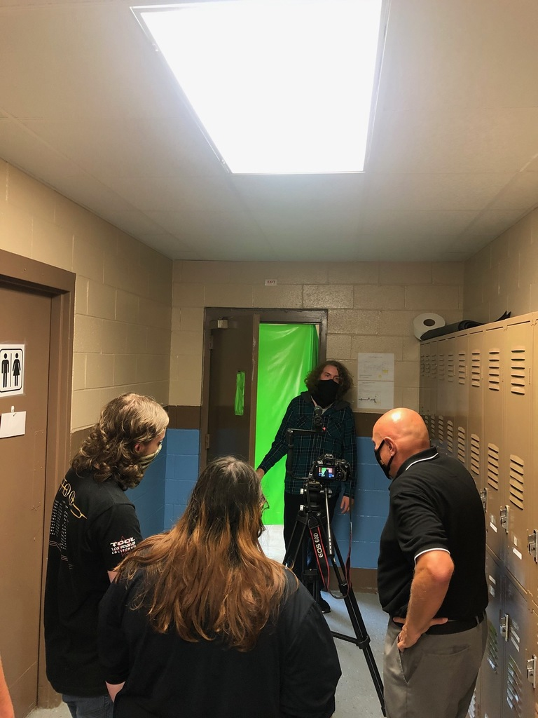 "Students using the ""Green Screen"" to create a mock fire."
