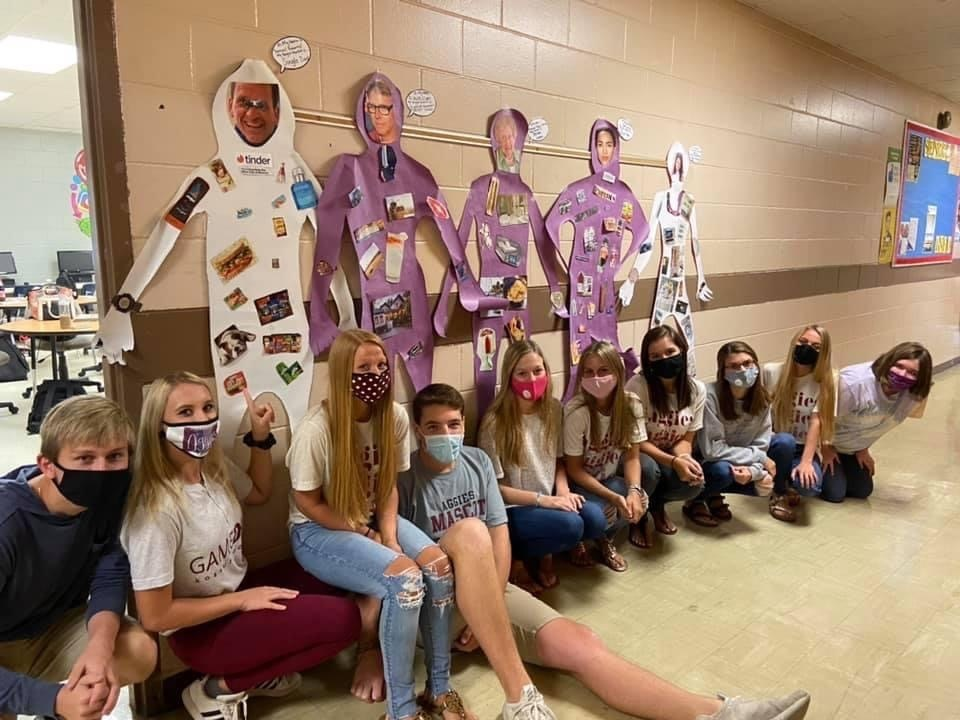 Students pose with their Target Market Cutout People